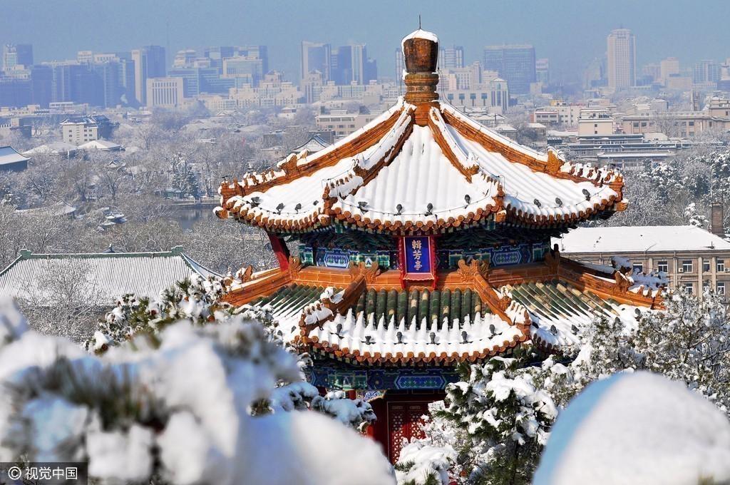 贴图园地  北京时间讯 20日晚间,北京迎来今年冬天的第一场雪.